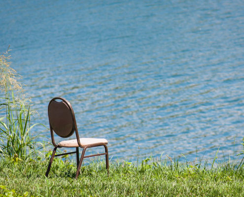 A chair next to the Cumberland River