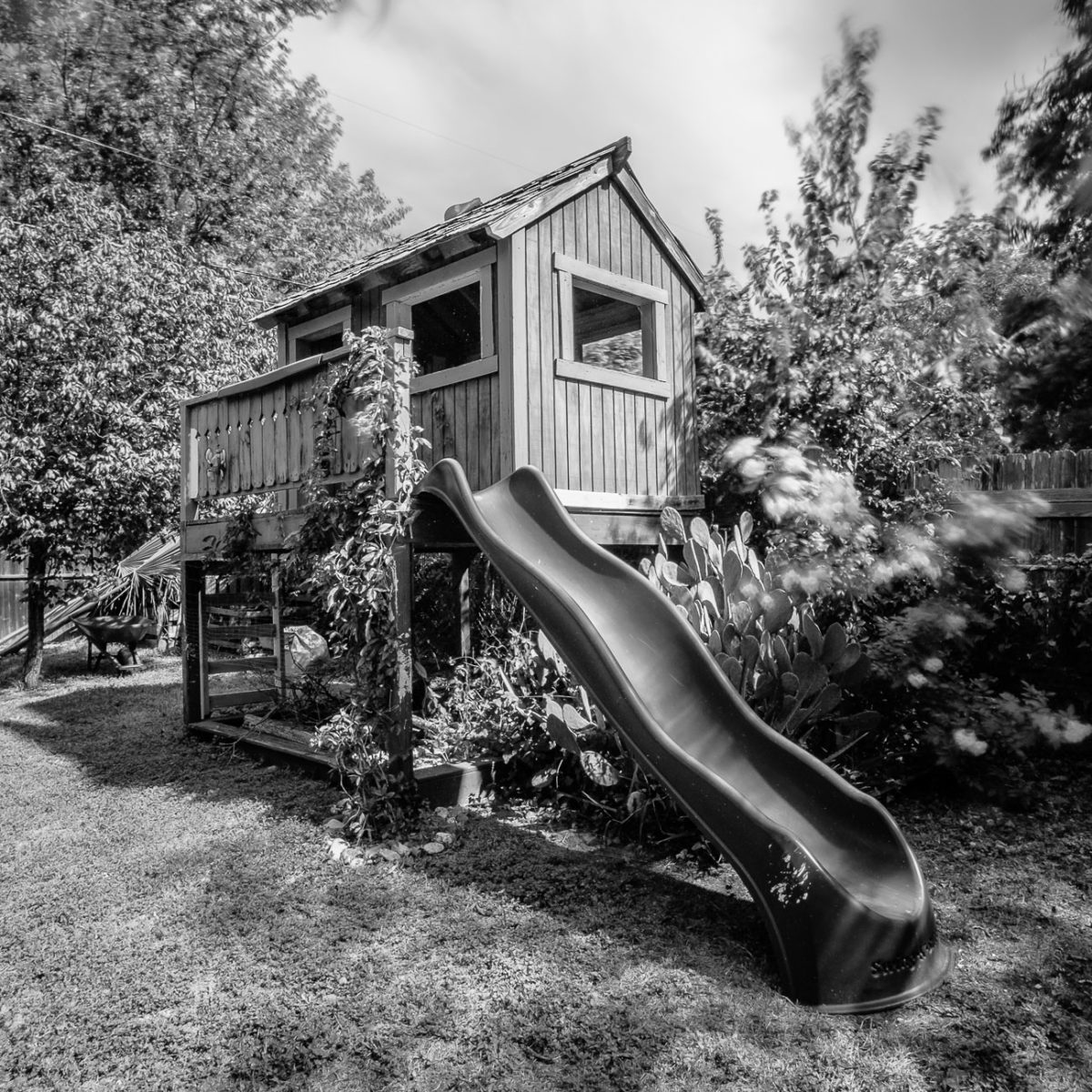 Childrens playhouse with slide - black and white photograph