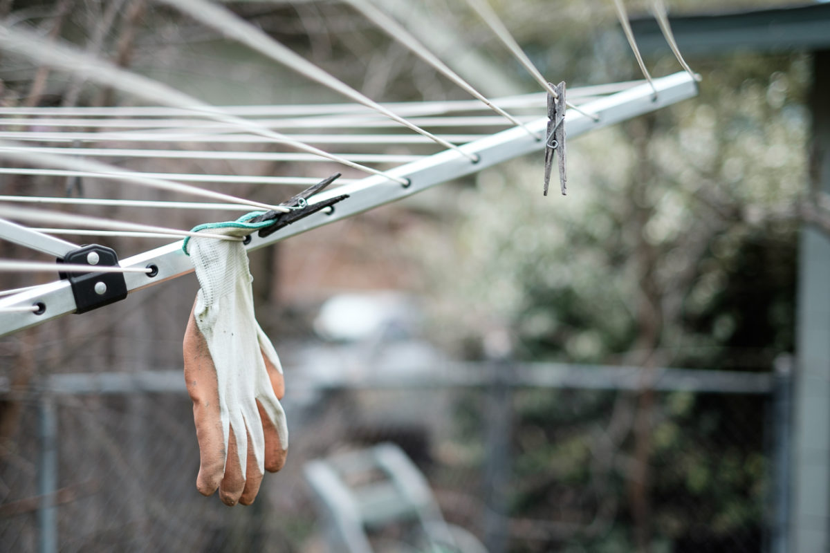 Glove hanging on a clothesline