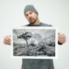 "Matt Mikulla holding ""Hill Country Delight"" black and white photograph"
