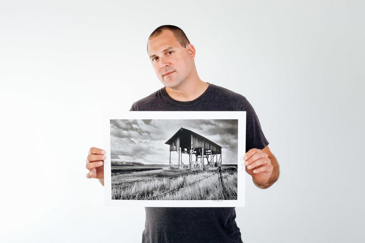 Matt Mikulla holding the black and white print