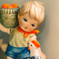 Hummel Boy Holding Basket With Rooster