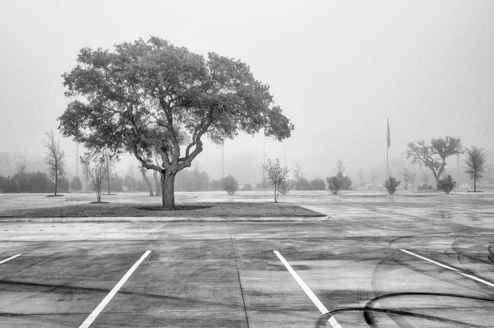Black and white photograph of a parking lot