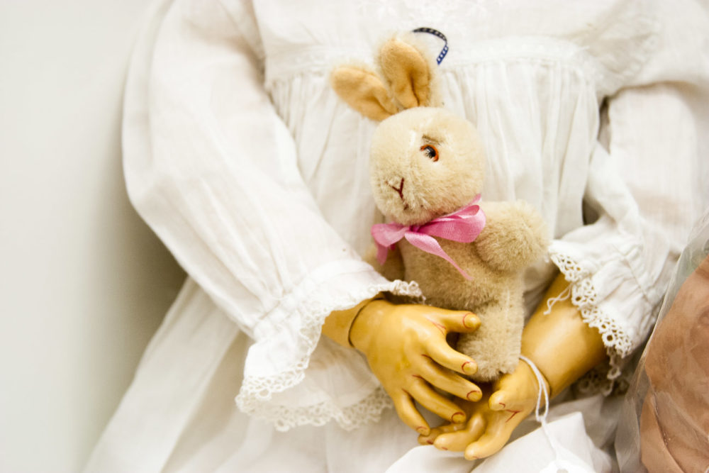 Photograph of a doll holding a bunny
