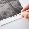 Signing a black and white photograph